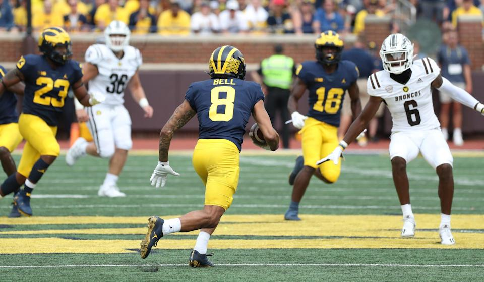 Michigan Wolverines wide receiver Ronnie Bell (8) returned this punt 31 yards vs. the Western Michigan Broncos before doing down with an injury immediately after the play Saturday, Sept. 4, 2021 at Michigan Stadium.