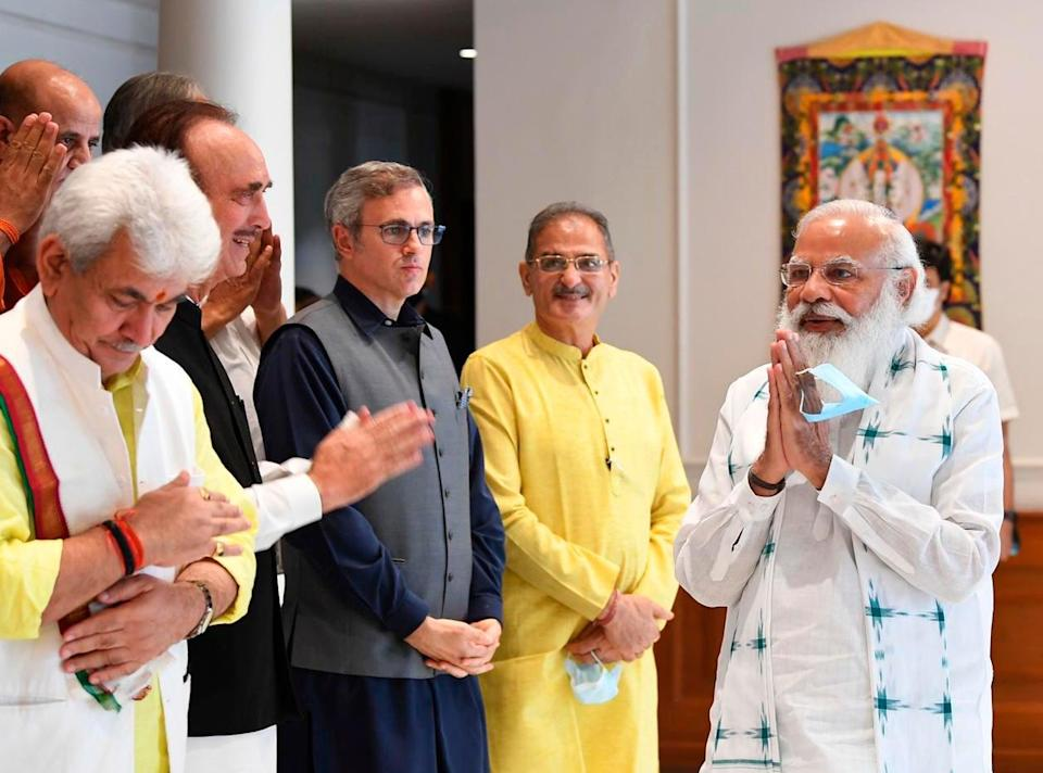 The photograph provided by the Prime Minister's Office shows Indian PM Narendra Modi greeting members of various political parties before their meeting in New Delhi on 24 June, 2021 (AP)