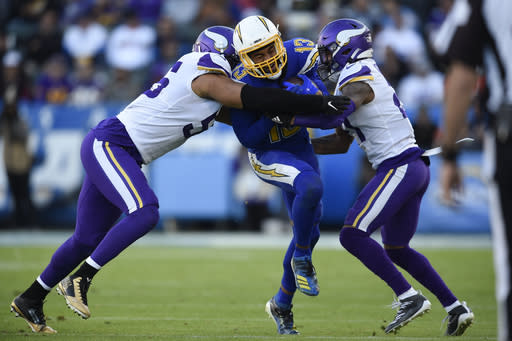 Los Angeles Chargers wide receiver Keenan Allen, center, is brought down by Minnesota Vikings center Garrett Bradbury, left, and cornerback Mike Hughes, during the second half of an NFL football game Sunday, Dec. 15, 2019, in Carson, Calif. (AP Photo/Kelvin Kuo)