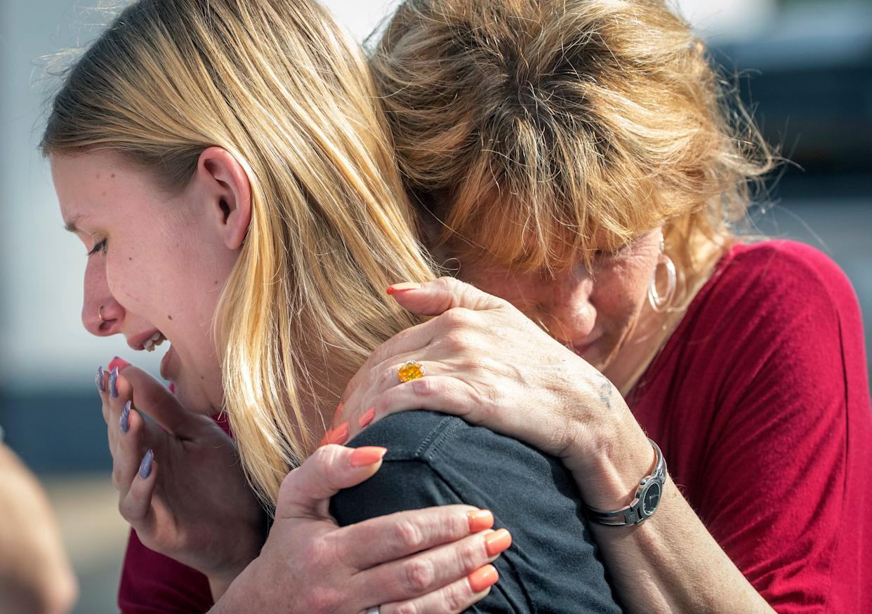 Santa Fe High School student Dakota Shrader is comforted by her mother Susan Davidson following a shooting at the school on Friday, May 18, 2018, in Santa Fe, Texas. Shrader said her friend was shot in the incident.