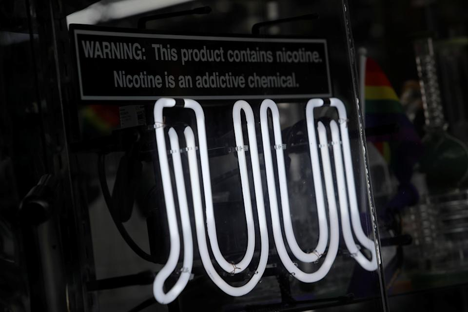 Signage for Juul vaping products is seen on a storefront in New York City, U.S., September 9, 2019. REUTERS/Andrew Kelly