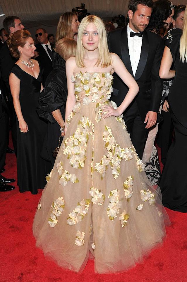 "<b>Dakota Fanning:</b> The NYU freshman is a true fashion risk-taker at heart, so it's not surprising that she pulled off this flower-embellished Marchesa gown. She earned bonus points for letting her dress shine by wearing minimal makeup and accessories.(05/02/2011)<br><br><a target=""_blank"" href=""http://www.seventeen.com/fashion/tips/worst-dressed-stars-2011?link=emb&dom=yah_omg&src=syn&con=slide&mag=svn"">The Worst-Dressed Stars of 2011</a>"