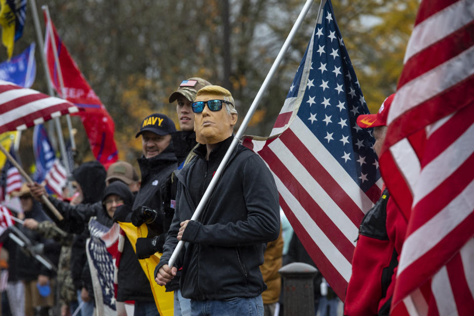 Supporters of President Donald Trump attend a ' Stop The Steal ' rally at the Oregon State Capitol protesting the outcome of the election on Saturday, Nov. 14, 2020 in Salem, Ore. (AP Photo/Paula Bronstein)