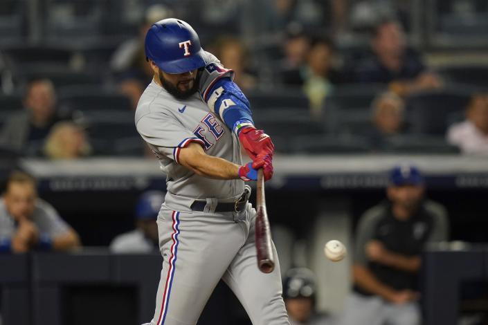 Texas Rangers' Isiah Kiner-Falefa hits an RBI-double during the fifth inning of a baseball game against the New York Yankees, Monday, Sept. 20, 2021, in New York. (AP Photo/Frank Franklin II)
