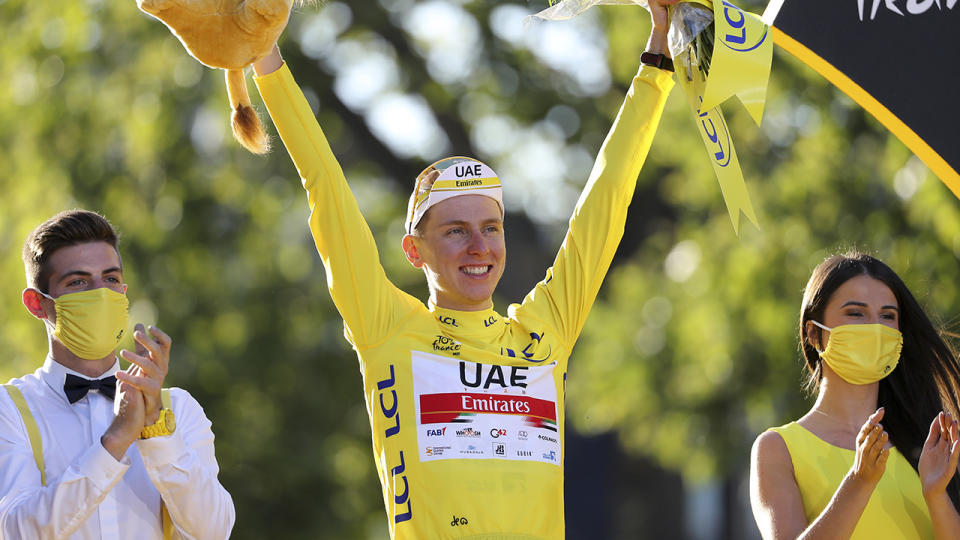 Tadej Pogacar, pictured here on the podium after winning the 2021 Tour de France.