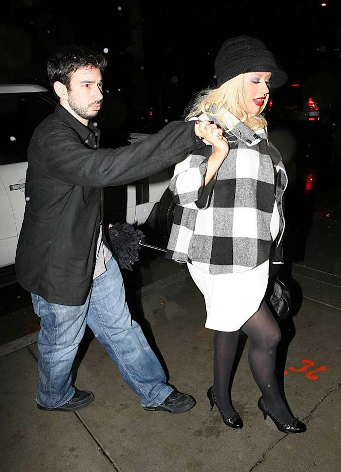 """Christina Aguilera walked hand-in-hand into her 27th birthday bash with hubby Jordan Bratman. The very pregnant pop star is expecting her first child early next year. <a href=""""http://www.x17online.com"""" target=""""new"""">X17 Online</a> - December 18, 2007"""