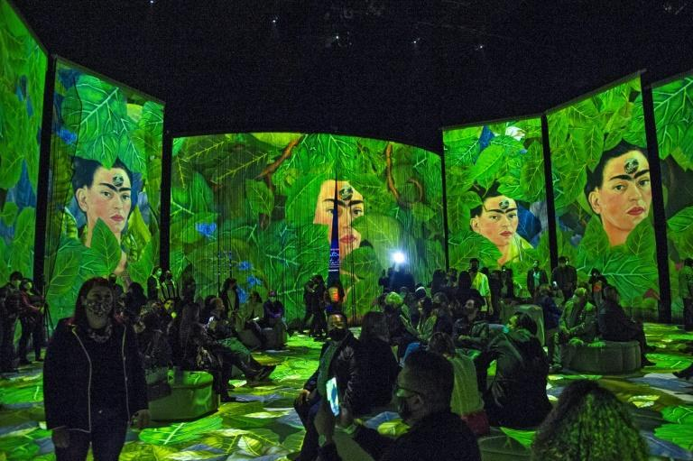 People attend the inauguration of a Frida Kahlo immersive exhibition in Mexico City