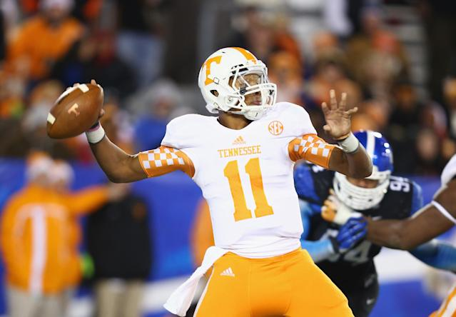 LEXINGTON, KY - NOVEMBER 30: Joshua Dobbs #11 of the Tennessee Volunteers throws a pass during the game against the Kentucky Wildcats at Commonwealth Stadium on November 30, 2013 in Lexington, Kentucky. (Photo by Andy Lyons/Getty Images)