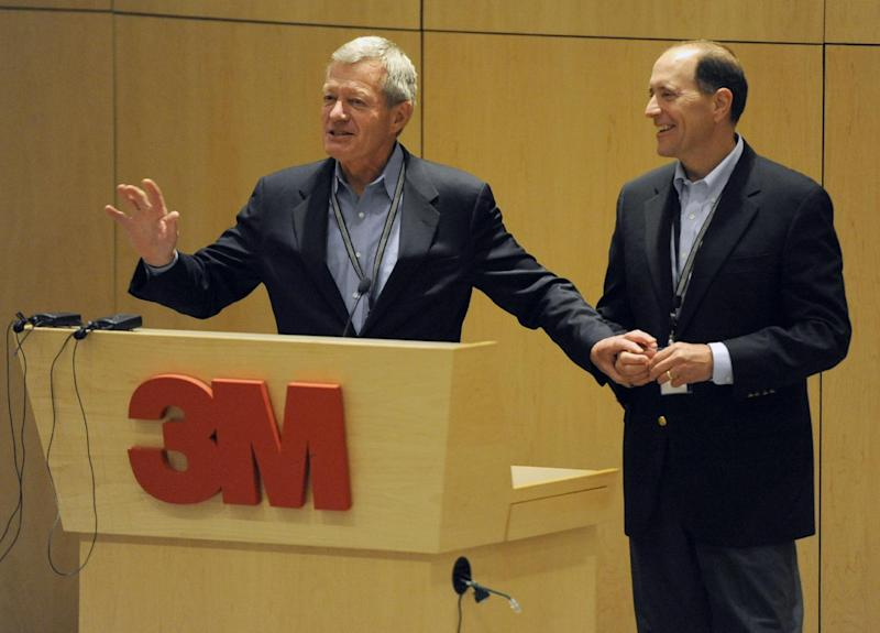 In this photo taken July 8, 2013, Senate Finance Committee Chairman Sen. Max Baucus, D-Mont., left, and the House Ways and Means Committee Chairman, Rep. Dave Camp, R-Mich., talk about tax reform to 3M employees at the 3M Innovation Center in Maplewood, Minn. Two of the most powerful members of Congress, Baucus, a Democrat, and Camp, a Republican, are touring the country to rally support for their effort to overhaul the nation's tax laws. They've developed a close friendship as they work to attract other lawmakers to their cause while helping Democrats and Republicans get to know each other a bit better. Their secret weapon: burgers and beer. (AP Photo/Hannah Foslien)