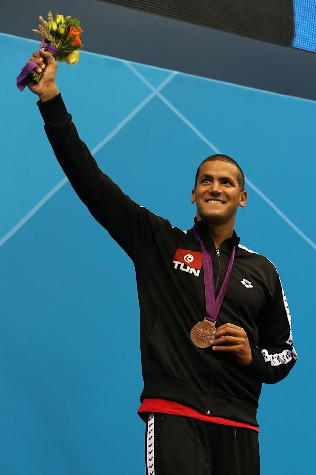 LONDON, ENGLAND - AUGUST 04:  Bronze medallist Oussama Mellouli of Tunisia poses on the podium during the medal ceremony for the Men's 1500m Freestyle Final on Day 8 of the London 2012 Olympic Games at the Aquatics Centre on August 4, 2012 in London, England.  (Photo by Clive Rose/Getty Images)