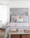 "<p>A repurposed barn door adds texture and interest to this rustic bedroom retreat. Use reclaimed wood as your starting point to create a one-of-a-kind piece, adding lights for reading. How <a href=""https://www.goodhousekeeping.com/home/decorating-ideas/g3755/farmhouse-escape-home-tour/"" rel=""nofollow noopener"" target=""_blank"" data-ylk=""slk:farmhouse chic"" class=""link rapid-noclick-resp"">farmhouse chic</a>!</p>"