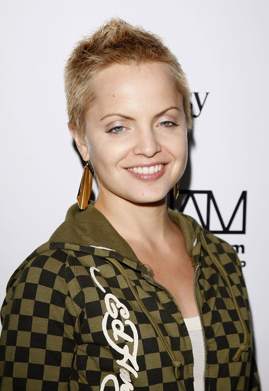 <p>Mena Suvari attended the Will.I.Am release party back in 2007 with a rocker-chick spiked blond cut. (Photo: WireImage) </p>