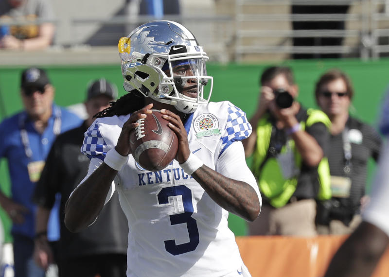 Kentucky quarterback Terry Wilson (3) looks for a receiver against Penn State during the first half of the Citrus Bowl NCAA college football game, Tuesday, Jan. 1, 2019, in Orlando, Fla. (AP Photo/John Raoux)