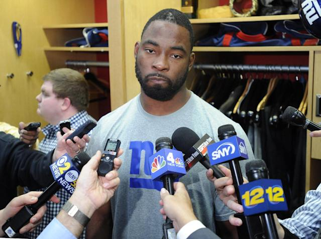 New York Giants' Justin Tuck speaks to the media Monday, Dec. 30, 2013, in East Rutherford, N.J. after the Giants season ended with a 7-9 record. (AP Photo/Bill Kostroun)