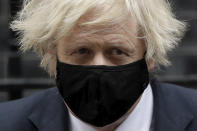 Prime Minister Boris Johnson leaves 10 Downing Street in London, to attend the weekly Prime Minister's Questions at the Houses of Parliament, in London, Wednesday, March 24, 2021. (AP Photo/Matt Dunham)