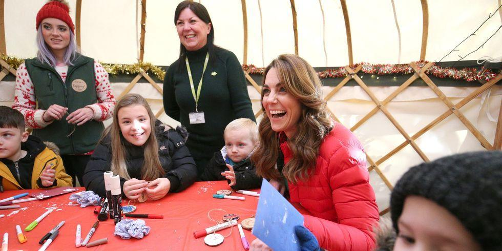 <p>Catherine, Duchess of Cambridge, laughs as she takes part in Christmas activities with families and children supported by the Family Action charity during a visit to Peterley Manor Farm in Buckinghamshire.</p>