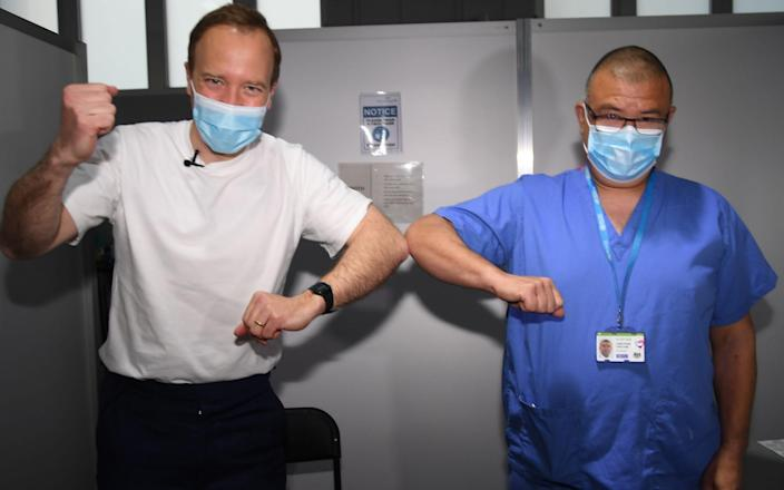 Matt Hancock and JVT celebrate as the Health Secretary gets the jab - Evening Standard / eyevine