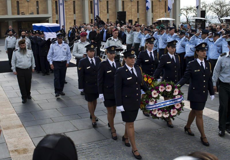 The coffin of late Israeli Prime Minister Ariel Sharon is carried after a state memorial ceremony at the Knesset Plaza in Jerusalem, Monday, Jan. 13, 2014. Israel is holding a state memorial ceremony for Sharon at the country's parliament building. Monday's official ceremony in the Knesset in Jerusalem will be followed by a private burial on the family's desert ranch in southern Israel. (AP Photo/Bernat Armangue)