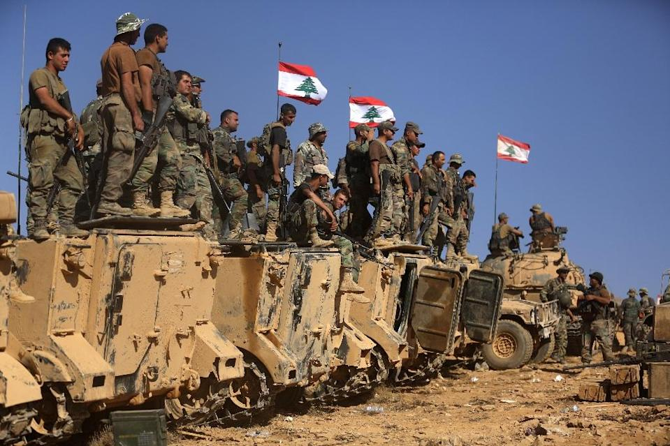 Lebanese soldiers stand on armoured vehicles on a hill they took from the Islamic State (IS) group in Jurud Ras Baalbek on the Syrian-Lebanese border, on August 28, 2017 (AFP Photo/PATRICK BAZ)