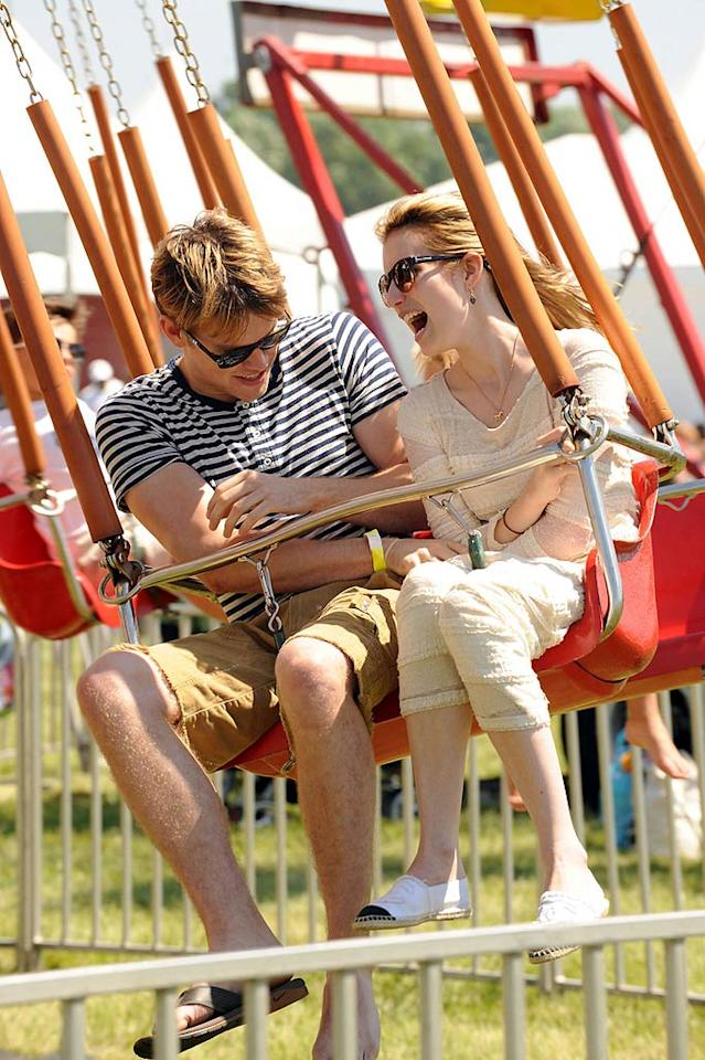 "New couple Emma Roberts and Chord Overstreet had a scream as they cozied up on a carnival ride at the Super Saturday charity shopping event in the Hamptons last weekend. Ah, young love ... Demis Maryannakis/<a href=""http://www.pacificcoastnews.com/"" target=""new"">PacificCoastNews.com</a> - July 31, 2011"