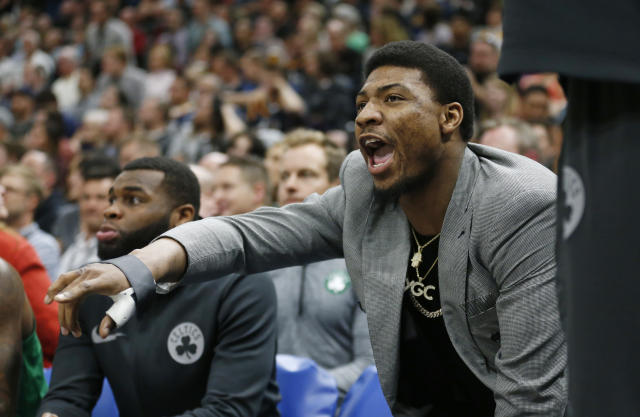 "<a class=""link rapid-noclick-resp"" href=""/nba/players/5317/"" data-ylk=""slk:Marcus Smart"">Marcus Smart</a> even controls the Celtics defense from the bench. (AP)"
