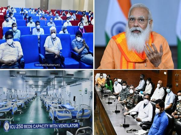 Prime Minister Narendra Modi interacting with doctors, paramedical staff and frontline workers of Varanasi on Friday.