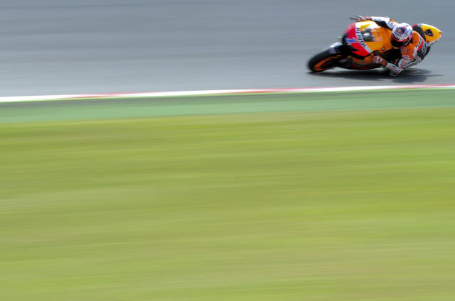 Repsol Honda Team's Australian Casey Stoner rides during a Moto GP training session at the Catalunya racetrack in Montmelo, near Barcelona, on June 4, 2012. AFP PHOTO / JOSEP LAGOJOSEP LAGO/AFP/GettyImages