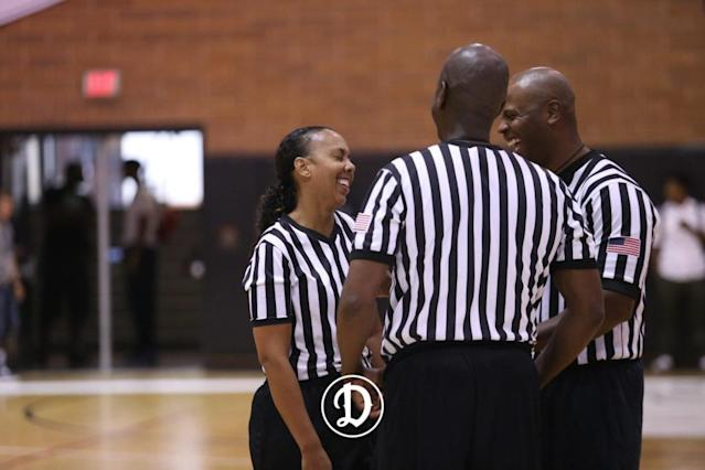 Crystal Hogan laughswith other Drew Leaguereferees. (Courtesy of the Drew League)
