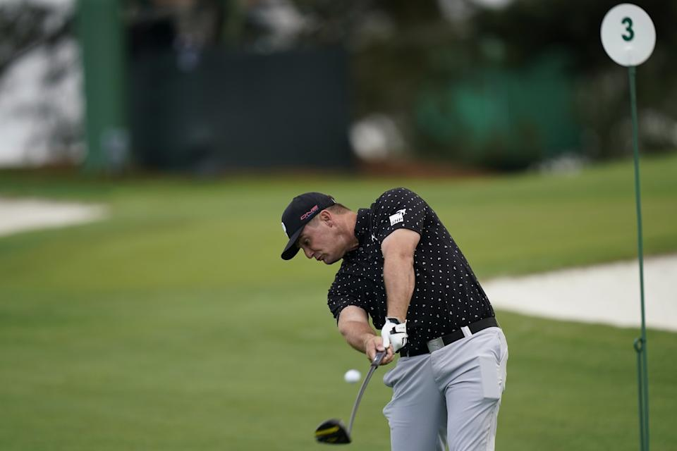 Bryson DeChambeau tees off on the third hole during a practice round for the Masters golf tournament.