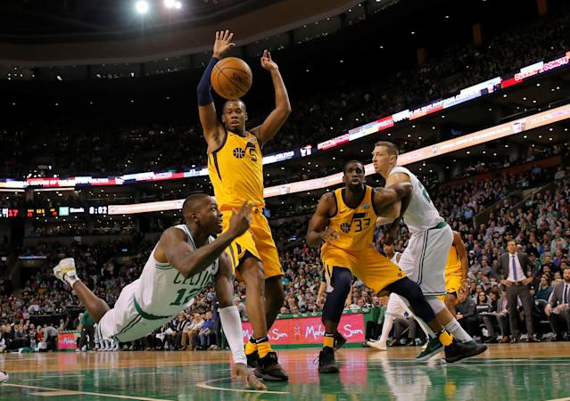 Dec 15, 2017; Boston, MA, USA; Boston Celtics guard Terry Rozier (12) works the ball against Utah Jazz guard Rodney Hood (5) in the first quarter at TD Garden. Mandatory Credit: David Butler II-USA TODAY Sports TPX IMAGES OF THE DAY