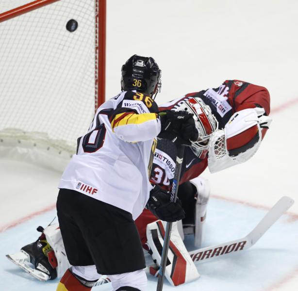 Germany's Yannic Seidenberg, left, watches as Canada's goaltender Matt Murray, right, fails to make a save during the Ice Hockey World Championships group A match between Canada and Germany at the Steel Arena in Kosice, Slovakia, Saturday, May 18, 2019. (AP Photo/Petr David Josek)