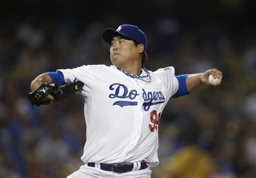 Los Angeles Dodgers starting pitcher Hyun-Jin Ryu, of South Korea, throws to the San Francisco Giants during the second inning of a baseball game in Los Angeles, Tuesday, April 2, 2013. (AP Photo/Jae C. Hong)