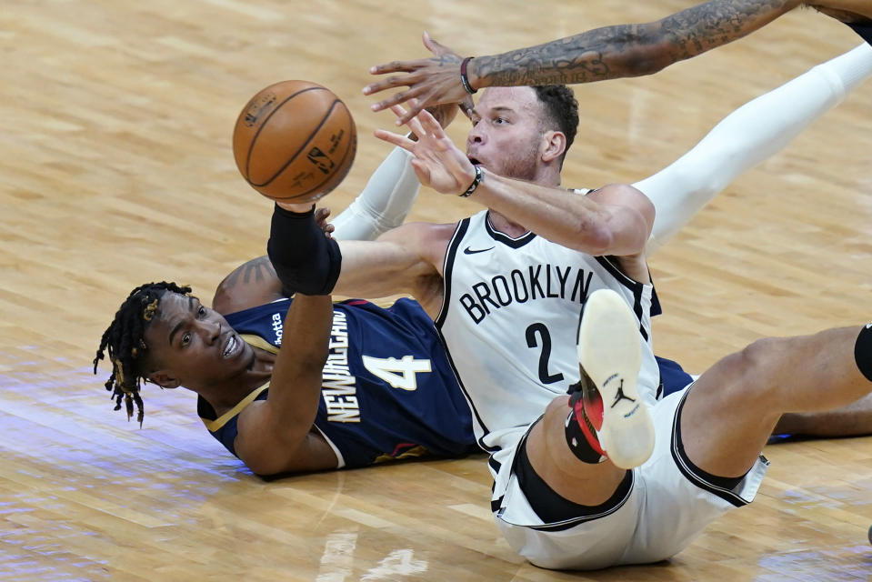 Brooklyn Nets forward Blake Griffin (2) passes the ball away from New Orleans Pelicans forward Wes Iwundu (4) in the first half of an NBA basketball game in New Orleans, Tuesday, April 20, 2021. (AP Photo/Gerald Herbert)