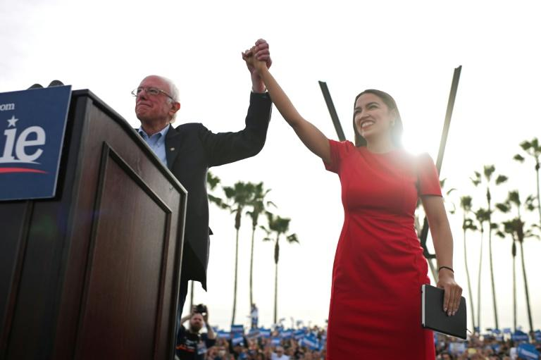 Bernie Sanders, pictured here with congresswoman Alexandria Ocasio-Cortez on December 21, 2019, is one of four US senators who are running for the Democratic presidential nomination while they attend the impeachment trial of President Donald Trump (AFP Photo/Robyn Beck)