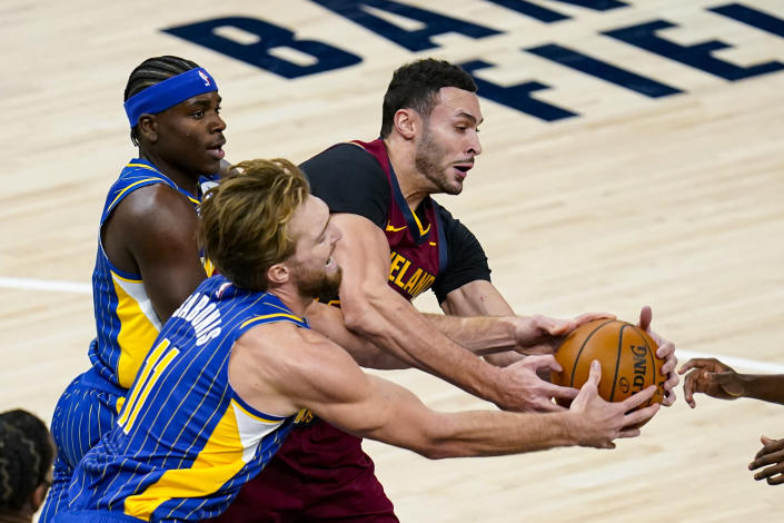 Indiana Pacers forward Domantas Sabonis (11) and Cleveland Cavaliers forward Larry Nance Jr. (22) fight for a long rebound during the first half of an NBA basketball game in Indianapolis, Thursday, Dec. 31, 2020. (AP Photo/Michael Conroy)
