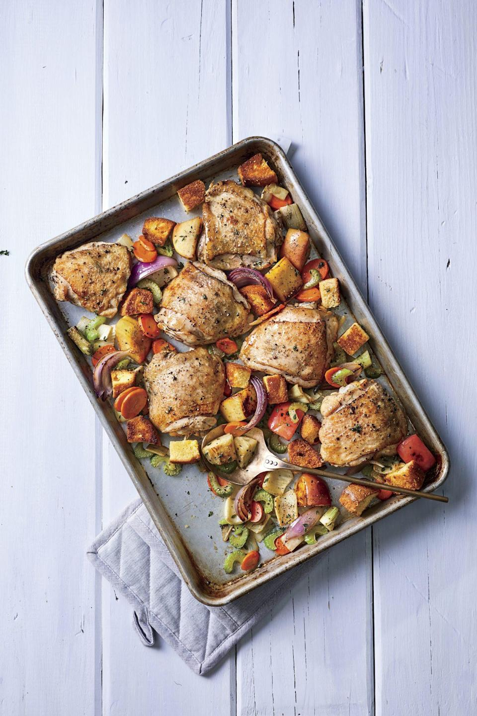 """<p><strong>Recipe: <a href=""""https://www.southernliving.com/recipes/baked-chicken-thighs"""" rel=""""nofollow noopener"""" target=""""_blank"""" data-ylk=""""slk:Baked Chicken Thighs with Dressing"""" class=""""link rapid-noclick-resp"""">Baked Chicken Thighs with Dressing</a></strong></p> <p>With fresh veggies, juicy chicken, and toasty chunks of cornbread, this sheet pan supper is almost like a deconstructed, roasted Panzanella.</p>"""