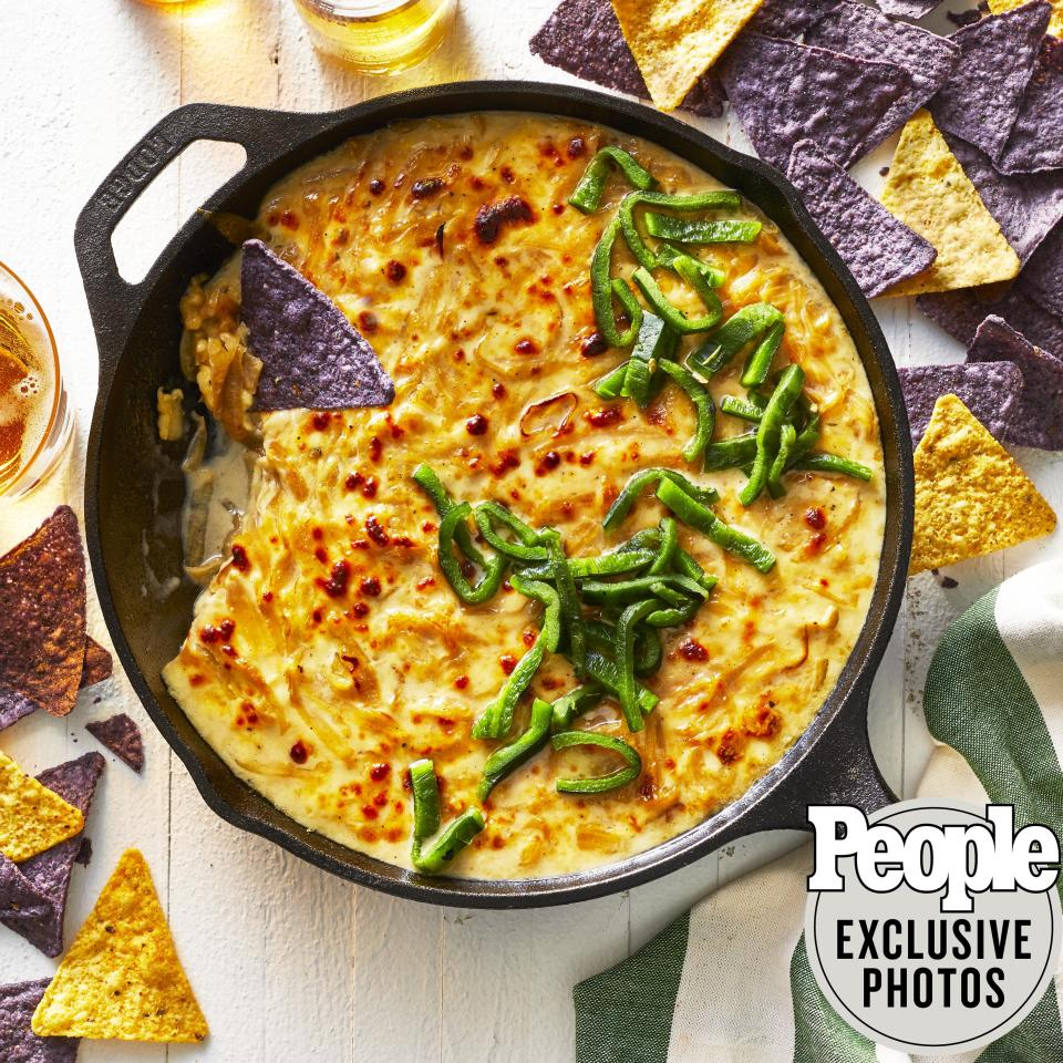 """A melty mash-up between classic French onion soup and queso fundido that is sure to score big with guests. """"I swear you will never look for another cheese dip in your life!"""" says the former <em>Top Chef</em> star.  Get the recipe <a href=""""https://people.com/food/claudette-zepedas-warm-french-onion-queso-fundido-dip/"""">HERE</a>."""