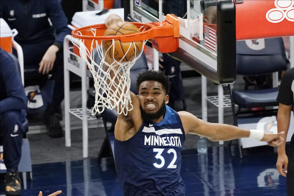 Minnesota Timberwolves' Karl-Anthony Towns dunks during the first half of the team's NBA basketball game against the Charlotte Hornets, Wednesday, March 3, 2021, in Minneapolis. (AP Photo/Jim Mone)