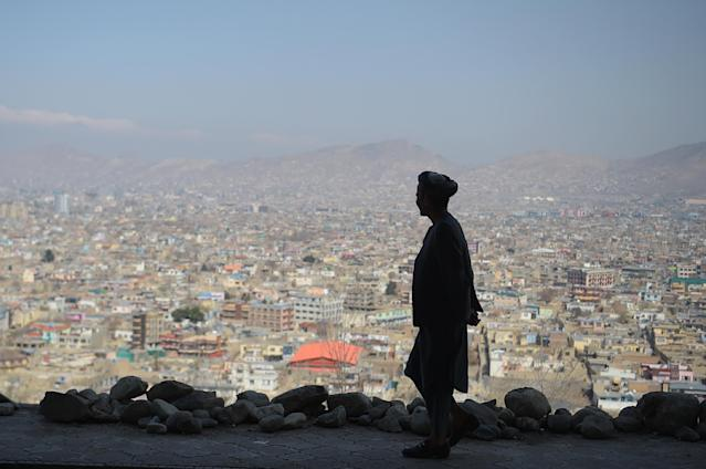 <p>An Afghan man walks during the first day of the Nowruz (Noruz), or Persian New Year, in a hilltop overlooking of Kabul on March 21, 2018. (Photo: Shah Marai/ AFP/Getty Images) </p>