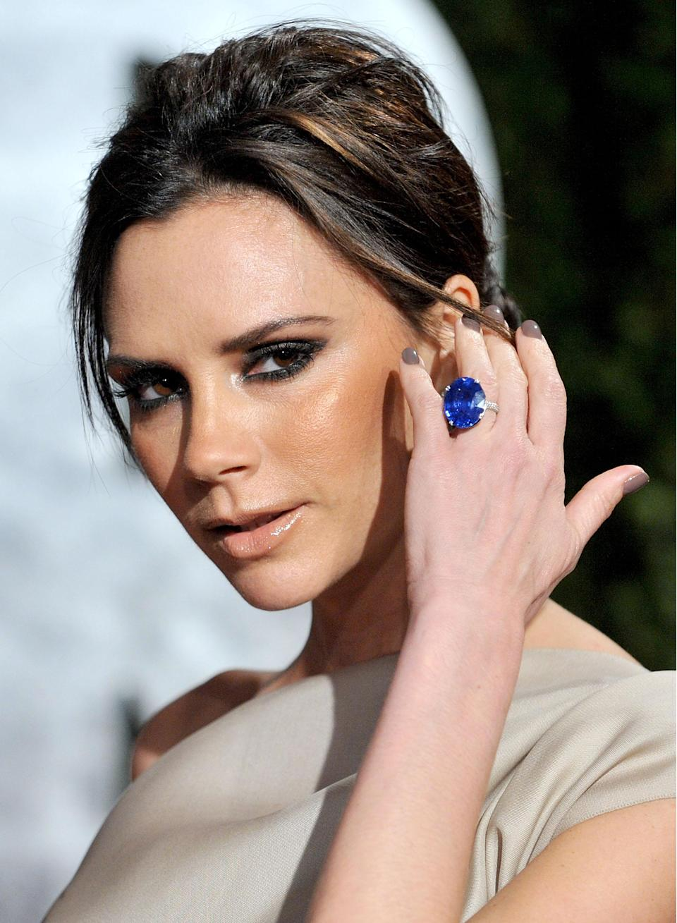 <p><strong>The specs: </strong>Continuing her penchant for large rare gems, David gifted Victoria this epic, oval-cut sapphire set on a platinu band of white diamonds in 2010. Wear it proudly, VB.<br><strong>The price: </strong>Definitely more than ten houses.<br>[Photo: Getty] </p>