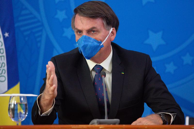 BRASILIA, BRAZIL - MARCH 20: Jair Bolsonaro President of Brazil reacts with wear protective mask during a press conference about outbreak of the coronavirus (COVID - 19) at the Planalto Palace on March 20, 2020 in Brasilia, Brazil. (Photo by Andressa Anholete/Getty Images)