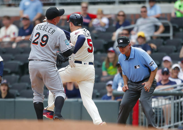 Atlanta Braves Freddie Freeman (5) beats out the throw to first to Miami Marlins relief pitcher Brad Ziegler (29) for a single in the ninth inning of a baseball game, Sunday, May 20, 2018, in Atlanta. (AP Photo/Todd Kirkland)
