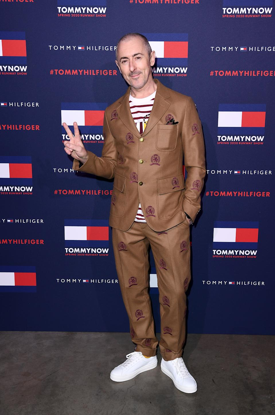 Alan Cumming arrives at the Tommy Hilfiger show. (Getty Images)