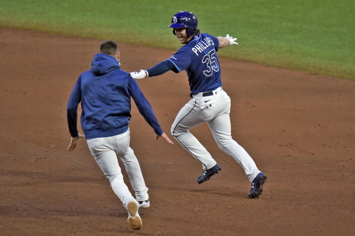 Tampa Bay Rays' Brett Phillips (35) celebrates his walk-off RBI single off New York Mets relief pitcher Aaron Loup with Kevin Kiermaier during the ninth inning of a baseball game Friday, May 14, 2021, in St. Petersburg, Fla. (AP Photo/Chris O'Meara)