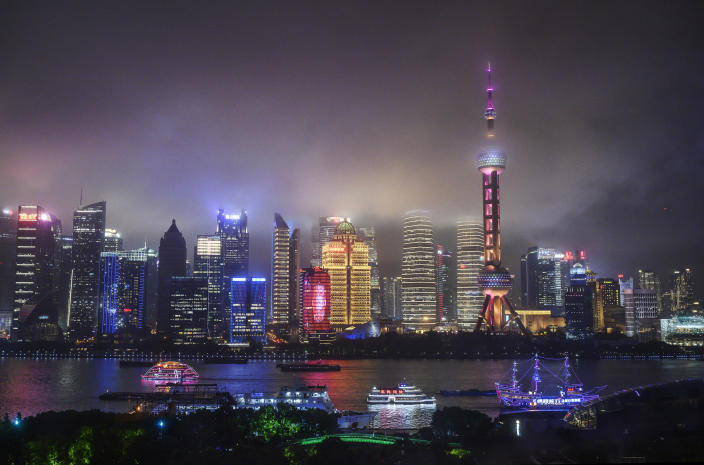 Image: Boats travel on the Huangpu River as the skyline of the city is is seen, including the Oriental Pearl TV Tower and the Shanghai Tower (Kevin Frayer / Getty Images file)