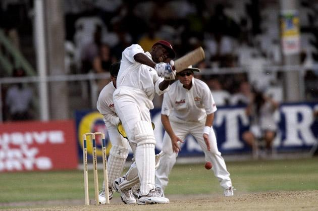 28 Mar 1999:  Curtly Ambrose of the West Indies batting against Australia in the Third Test at the Kensington Oval in Bridgetown, Barbados. The West Indies won by 1 wicket to go 2-1 up in the series. \ Mandatory Credit: Ben Radford /Allsport