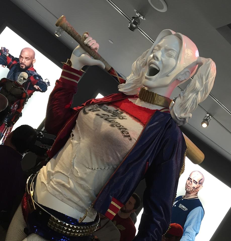 """<p>Destined to be the Squad's breakout psycho, Harley Quinn (Margot Robbie) accessorizes with a a """"Daddy's Lil Monster"""" T-shirt, """"Puddin"""" choker (her term of endearment for her on-off BF, the Joker), and Louisville Slugger.</p>"""