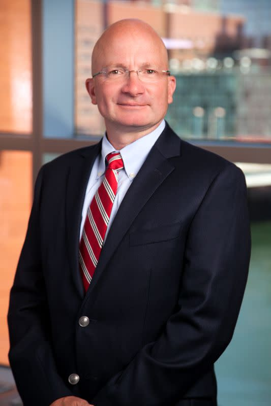 FILE PHOTO: Tony Dwyer, Canaccord Genuity's Chief Market Strategist poses for a picture in Boston