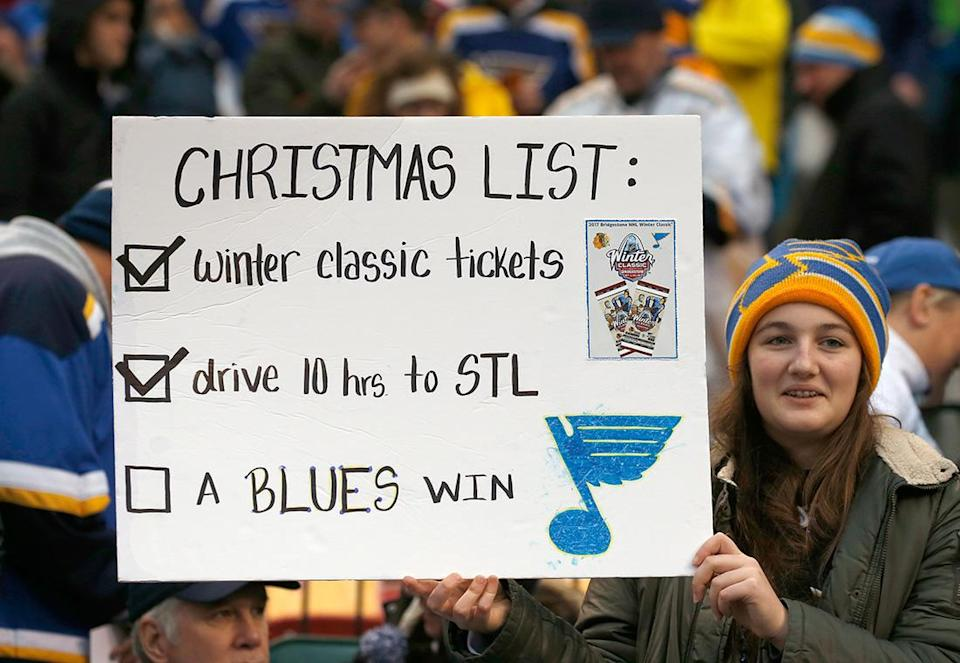 <p>ST LOUIS, MO – JANUARY 02: A fan holds a sign in the stands during the 2017 Bridgestone NHL Winter Classic between the St. Louis Blues and the Chicago Blackhawks at Busch Stadium on January 2, 2017 in St Louis, Missouri. (Photo by Eliot J. Schechter/NHLI via Getty Images) </p>