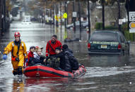 Emergency workers rescue residents of Little Ferry, New Jersey, from flood waters brought by Superstorm Sandy. (Reuters/Adam Hunger)